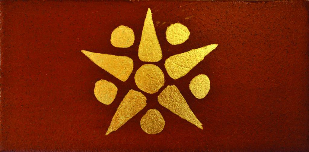 pulumza-oro-su-terracotta
